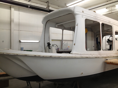 Houseboat stripped of hardware, windows, rub rail and other pieces